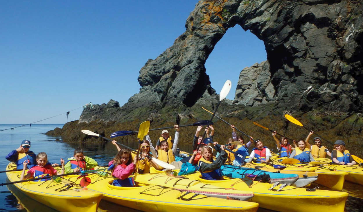 Kids kayaking at the Hole-in-the-Wall at North Head Campground and Park